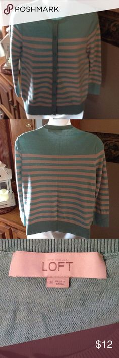 Loft button front sweater Ann Taylor Loft Button Front Sweater. Size M.  Great Preowned Condition. 54% Cotton 40% Rayon 6% Wool. Cute!! Any questions please ask. Thank You 😊.   Color is like a teal and gray or possible tan color ? LOFT Sweaters Cardigans