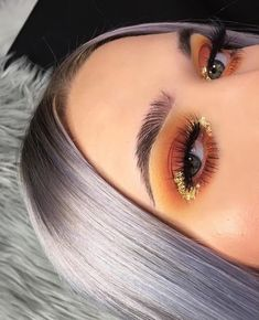 Feathered brows: orange and gold glitter eye makeup with feathered brows, this look is such makeup #goals.