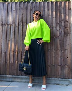 Neon pullover, pleated skirt and sandals | For more style inspiration visit 40plusstyle.com