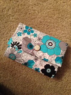 Hard body expandable clutch embellished with decorative button
