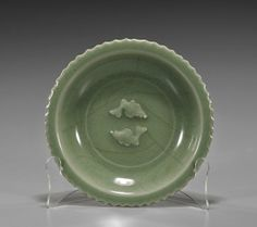 """Chinese Southern Song Celadon Glazed Bowl, Song Dynasty, Longquan celadon glazed bowl; circular form, shallow and foliate rim, with twin fish design (some glaze crackle); D: 7 1/8"""""""