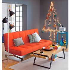 flex orange sofa. good for watching movies or for a guest to crash on.  love the orange.
