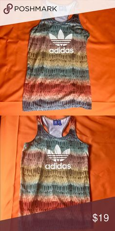 NWOT Adidas Feather Tank Top Never worn Tank top. Really beautiful colors . Length is 62 cm (24 in) from the neckline to hem so since I have huge hips and small waist it was too long for my frame . adidas Tops Tank Tops