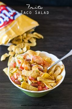 This Frito Taco Salad is one of our favorite family salads. It's full of lettuce, tomato, cheese, beans and a sweet & spicy dressing. You'll...