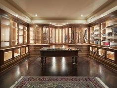 Discover the top 100 best gun room designs featuring cool armories you'll want to acquire. Explore traditional cabinetry to modern shelving security. Gun Safe Room, Revolver, Reloading Room, Gun Vault, Gun Rooms, Trophy Rooms, Rich Home, Gun Storage, Secret Rooms