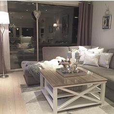 Gray and white decor. Love the coffee table