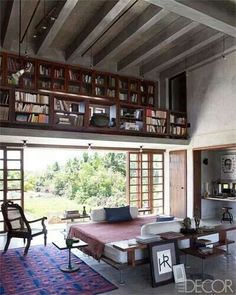 Loft with library and awesome louvered window-doors.  This is perfection.