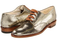 Jasc by Robert Clergerie. Metallic oxfords are both formal and unconventional. Instead of opting for standard metallic flats, step out in these androgynous kicks and add something unique to the scene.