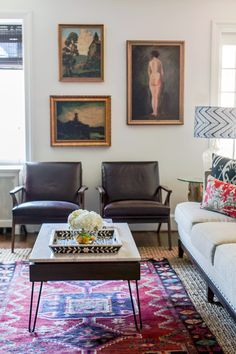 Gentleman's Bachelor Pad by Design Manifest-Danish Chairs paired with vintage paintings #gallerywall #tribalrug