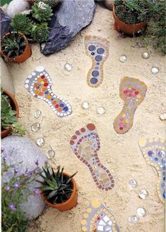 Mosaic art in the garden      Source     Flip-flops stepping stone         Source     Mosaic Frog       Source     Pebble mosaic feather  ...