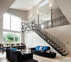 Juventa Mews,  Living room and staircase to balcony