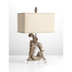 The Cyan Design Posy traditional table lamp features an intricately carved base with curls and flourishes and a coordinated finial. Crystal clear base, Limed Gracewood finish and rectangular shade with light linen tones. Wood Table Design, Table Lamp Wood, Traditional Table Lamps, Bliss Home And Design, Cyan, Table Lamp Shades, Contemporary Table Lamps, Room Lamp, Transitional Decor