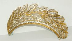 French tiara, c. 1820, is set in a patterned, gilded frame with faceted crystals. It depicts a spray of hyacinth leaves with raised flower buds