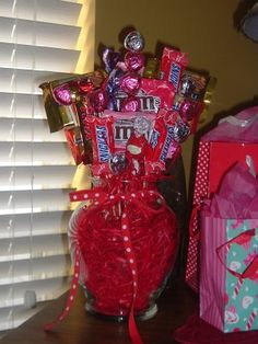 DIY!  Make a Valentine's Candy Vase for someone special. Just take a glass vase and fill up with candy, then glue some candy to some skewers stick in the vase. Add a pretty ribbon and your done!