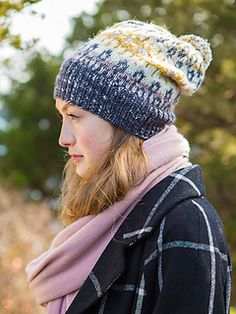 Worked in the round from the bottom up, Mira is a beautiful stranded colorwork hat with an optional pom-pom on top.