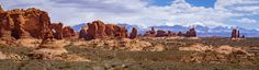 A little of everything that makes up Utah; mountains snow sagebrush and red rock. Arches National Park [5000 x 1369] [OC]
