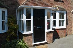 porch uk, black door, white windows