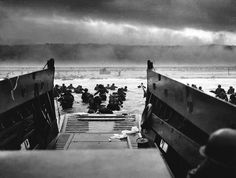 This remains one of the most iconic images of the American landings at Omaha Beach, photographed by Robert F. Sargent of the U.S. Coast Guard (June 6, 1944)