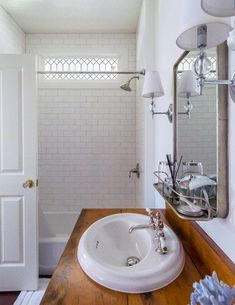 White Vintage Bathroom in Cape Cod Cottage New England Cottage, Painted Beams, Brick Cottage, Waterfront Cottage, Open Concept Floor Plans, Hanging Light Fixtures, Upstairs Bathrooms, Decorating Small Spaces, Beautiful Bathrooms