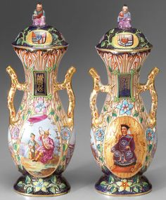A pair of Old Paris~Chinoiserie urns and covers~Fine hand painted decoration in the Asian Taste with gilt highlights~each with oval cartouche with seated figure on gilt ground~Lids with vertical panels and characters Finials with seated figures~Origin France~Circa 1801-1900