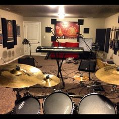 View from the drum set. Band room is a mess. Tool poster. Alex Grey artwork to the left.