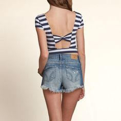 Hollister Bow Back Striped Crop Top sz S Pre-loved! Super cute natural waist crop top with lovely bow back detail. Slim fit. Sooooo cute with high waisted shorts!! Note: The last photo is NOT correct for color. Shown for fit only. Hollister Tops Crop Tops