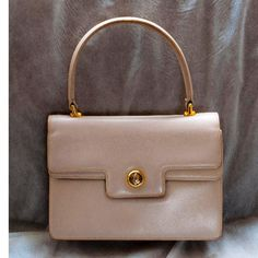 Tip: Gucci Handbag (Mauve)