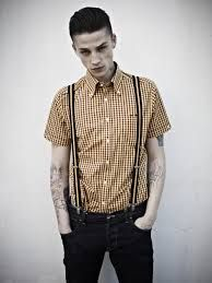 756dd566e78b53 Brutus X Dr. Martens - The Brutus X Dr. Martens Trimfit shirt features  classic punk tailoring that will turn any guy into a desirable rubeboy  instantly.