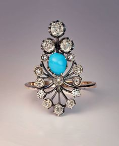 Late 19th Century Turquoise And Diamond Ring. a fan shaped silver topped gold ring set with old cut diamonds and a cabochon cut turquoise. circa 1890