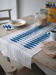 Brighten up your dining table with these printed linen table runners featuring a vintage design by Marianne Nilsson. Use one across the length of your table or try a couple the other way, they work wonderfully as place settings.  45cm x 140cm 55% linen 45% cotton