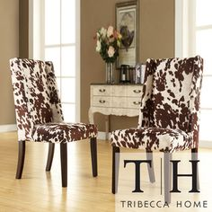 @Overstock.com.com - TRIBECCA HOME Ian Brown Cow Hide Wingback Dining Chair (Set of 2) - Inject style into your home with this wingback dining chair set. This dynamic duo features an attractive cowhide-print design that is sure to draw compliments from guests. Pair them with the coordinating chocolate-hued chairs for a striking contrast.  http://www.overstock.com/Home-Garden/TRIBECCA-HOME-Ian-Brown-Cow-Hide-Wingback-Dining-Chair-Set-of-2/7295823/product.html?CID=214117 $249.39