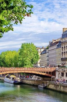 Paris…this is the bridge that goes halfway across the Seine to Notre-Dame, that is situated on Isle de la Cite'.