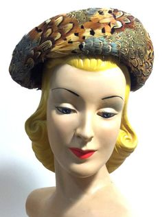 Asymetrical Pheasant Feather Curved Top Hat circa 1960s - Dorothea's Closet Vintage
