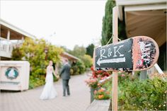 skate board wedding sign. we've NEVER seen this before! so fun!