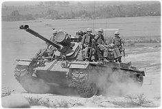 Tank photo: Marines of E Company, 2nd Battalion, 3rd Marines, riding on an M48A3 tank, Vietnam, 1966.