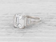 Vintage Art Deco diamond engagement ring set with a 2.56 carat emerald-cut diamond with GIA certificate stating the diamond is G color/VS1 clarity, accented with 6 baguette- cut diamonds. Set in platinum. Circa 1925