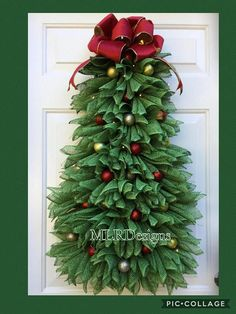 HURRY ONLY A FEW REMAIN FOR 2017! Gorgeous and can be made per your request! Decorate your door with this unique Christmas Tree Wreath. It is 32 in Height, 20 in width and 5-6 deep. This will hang on a regular wreath hanger or a hook. These are offered with or without lights. SEE