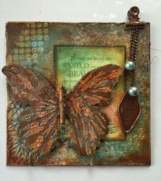Deborah Wainwright: Ya gotta love some rust! Mixed media butterfly plaque. #decoartprojects