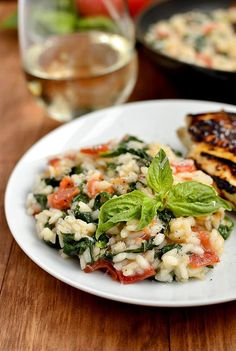 ---Tomato-Basil and Spinach Risotto---  2-1/2 cups chicken broth  1 Tablespoon butter  1 shallot, minced  1 garlic clove, minced  salt & pepper  3/4 cup arborio rice  1/4 cup dry white wine (I used pinot grigio)  2 vine-ripened tomatoes, seeded & chopped (or equivalent amount of Roma or Compari tomatoes)  2 cups baby spinach  handful torn basil  1/4 cup freshly grated parmesan cheese