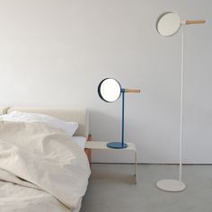 Me mirrors by Mathias Hahn for Asplund : these mirrors by London designer Mathias Hahn can be swivelled up and down with wooden handles sticking out the sides.