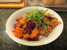 Roasted Butternut and Beetroot Salad - garnished with rocket.