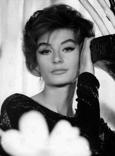 Anouk Aimee, La Dolce Vita.   Incomparable. Unforgettable. Impossible. Beyond control. Take as you would from a sugar bowl.