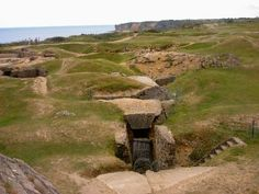"""Point du Hoc: """"D"""" Day- Went here with my grandparents and uncle on a WWII tour.. Pretty amazing place"""