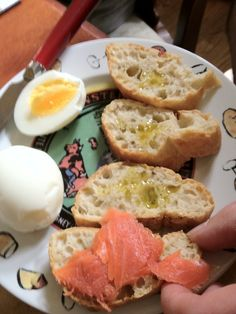 Salmon on toast with Chilean extra virgin olive oil and a hard-boiled egg.  Tasty breakfast!