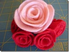 Umm, I never would have guessed that was how to make these!  http://snips-and-spice.blogspot.com/2011/01/felt-roses.html