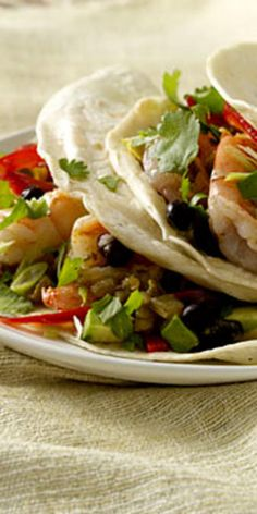 Cilantro-Lime Shrimp Tacos  - Though avocados are known best as the creamy main ingredient in guacamole, they are high in healthy monounsaturated fats and a good source of fiber, vitamins, and minerals.