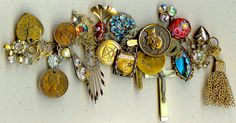Altered art bracelet: A charm bracelet by Kristen Peterson made using Lots of vintage rhinestones, coins, tokens, crucifixes, metal tagss beads and buttons
