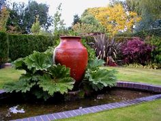 Big leaves.  Big urn.