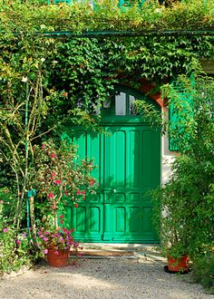 I want the lush foliage, contrasting colors and cottage-like atmosphere.   Artist - Monet's House Green Doors, Giverny, France