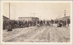 RP: Start line of Dog Derby Dog team race, Main Street , Meadow Lake, Saskatchewan, Canada 1937